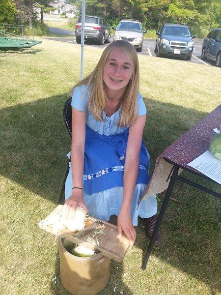 Mikayla Kraft making sauerkraut